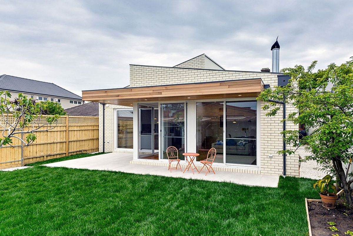 Wooden overhang gives a nice shaded patio that stretches into the garden