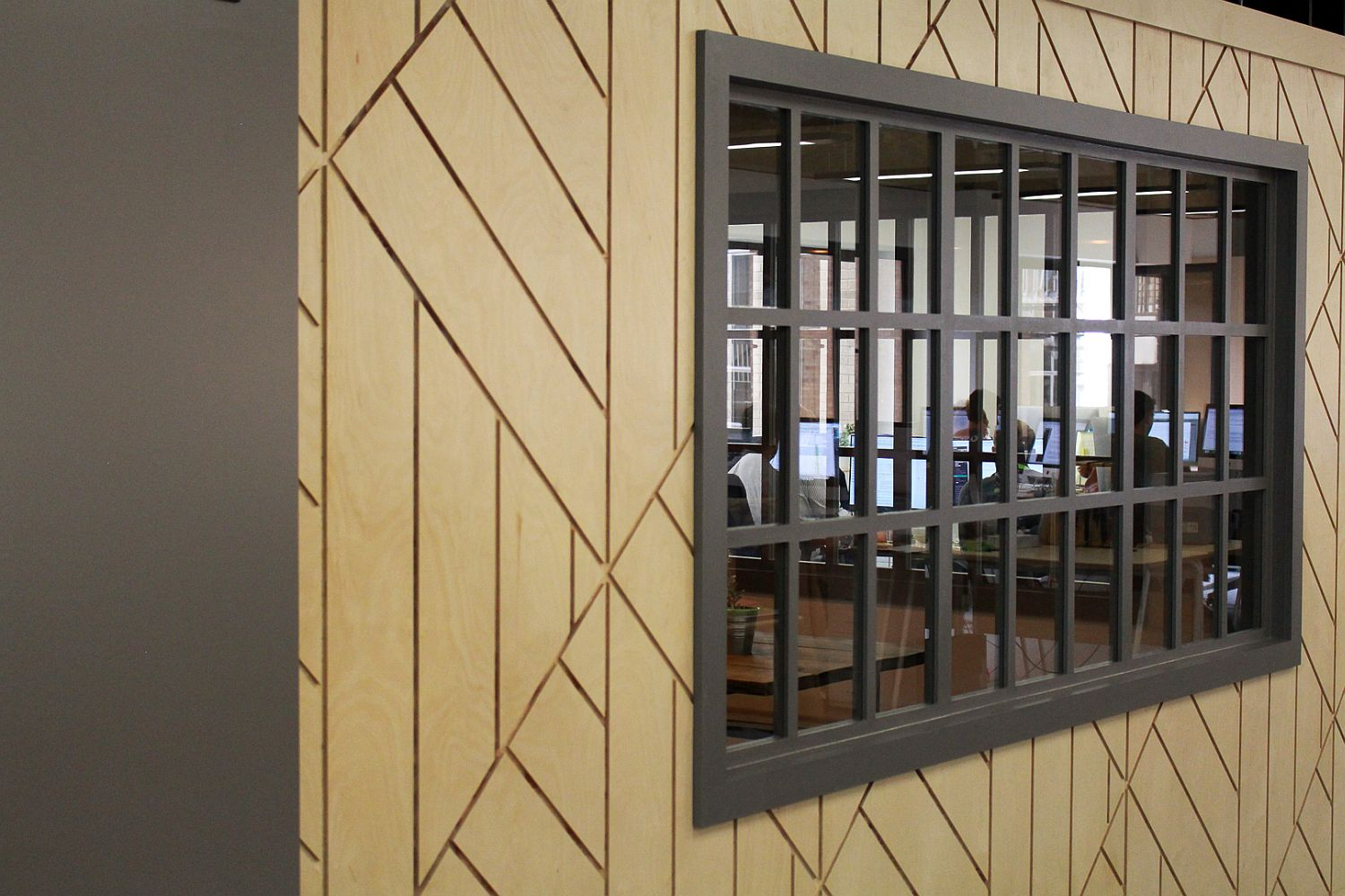 Wooden planks give the interior geo style and textural contrast