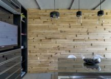 Wooden-wall-brings-warmth-to-the-office-in-steel-217x155