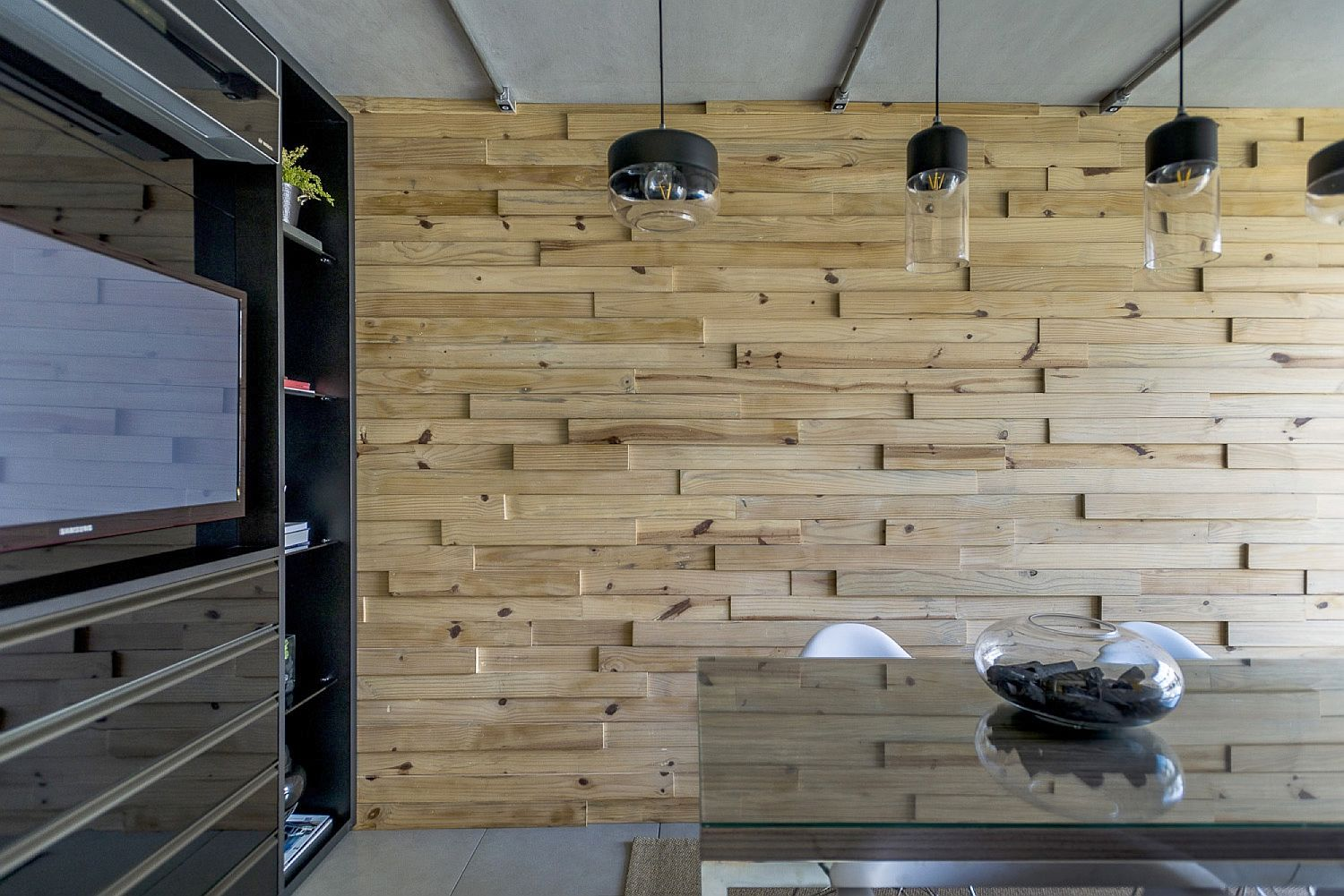 Wooden wall brings warmth to the office in steel