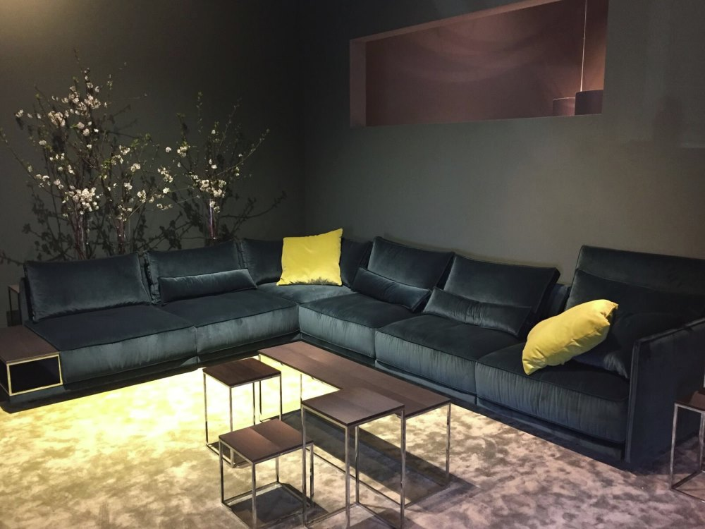 Yellow pillows on a charcoal sofa