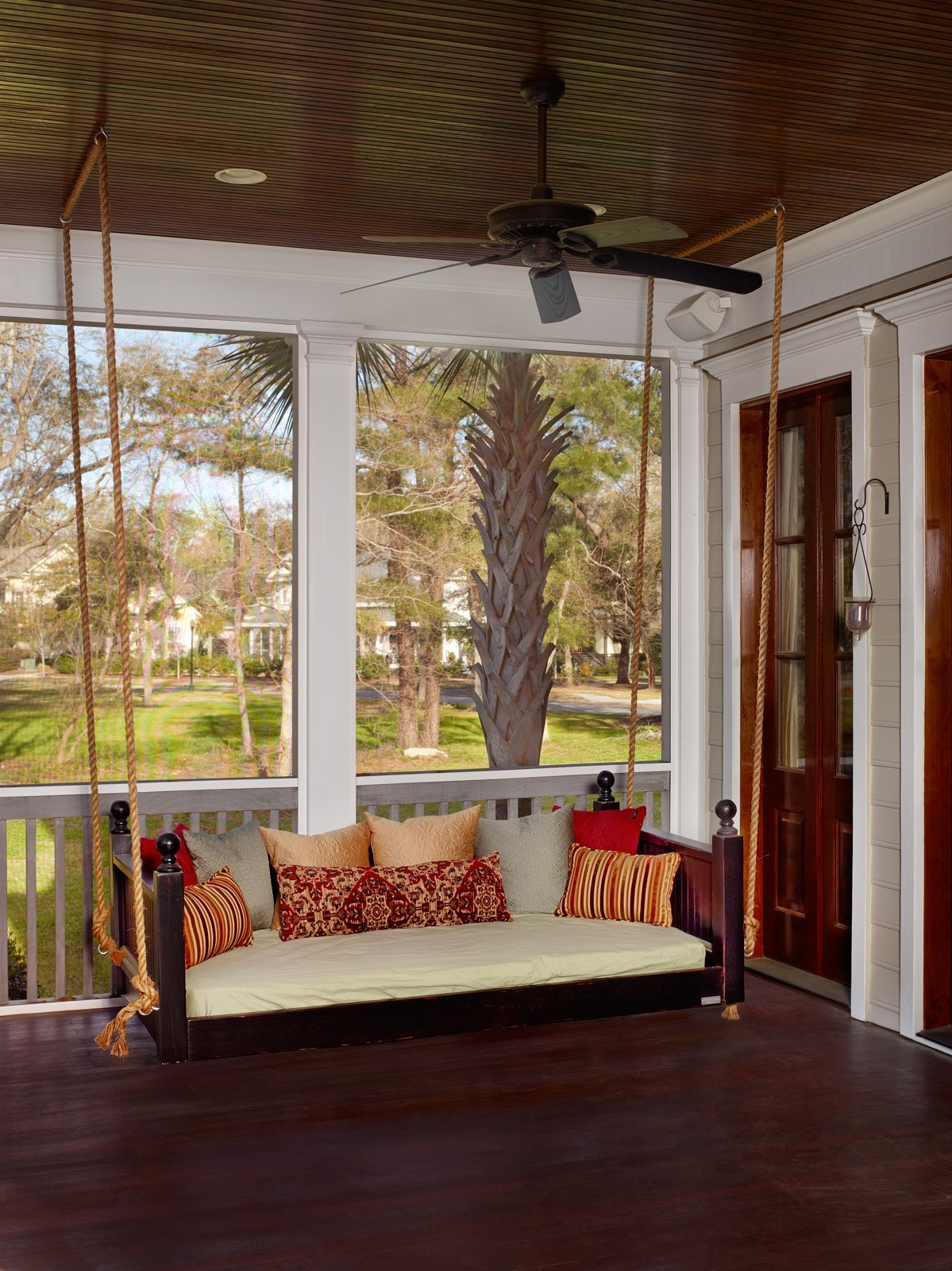A lively porch swing that immediately draws attention to itself