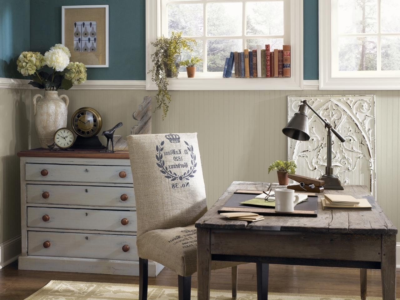 A rustic home office with some added color for diversity
