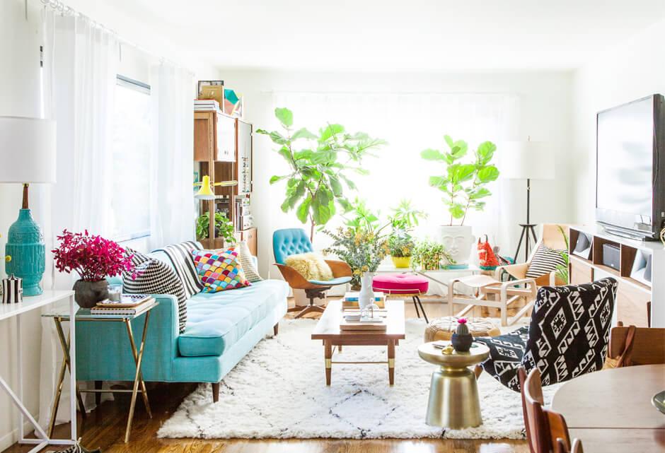 A striking mint sofa in a modern living room