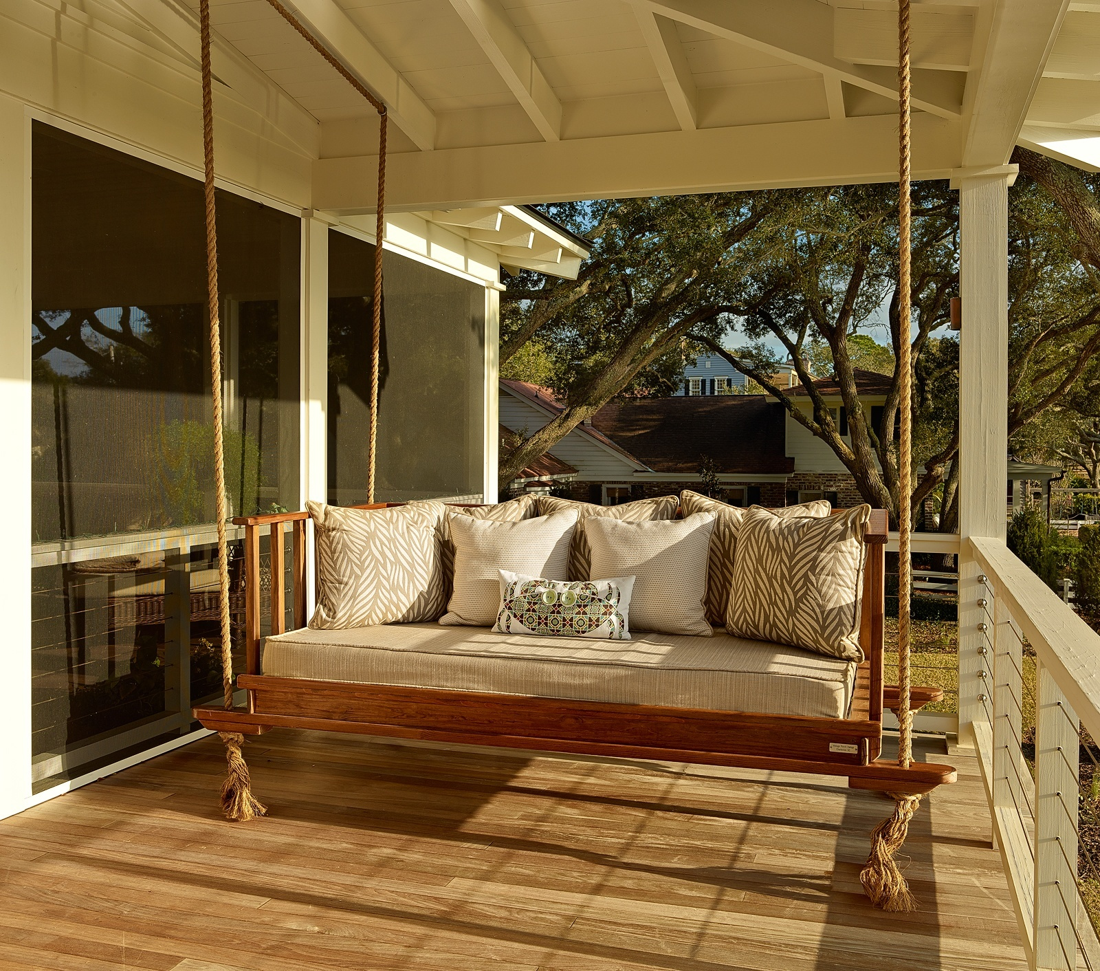 Getting ready for summer enliven your porch with comfy swings for Old porch swing