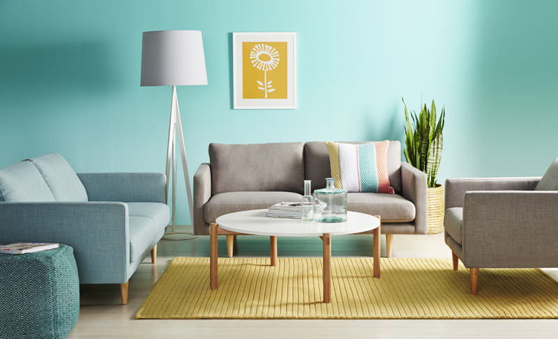 A vivid living room with vibrant mint walls