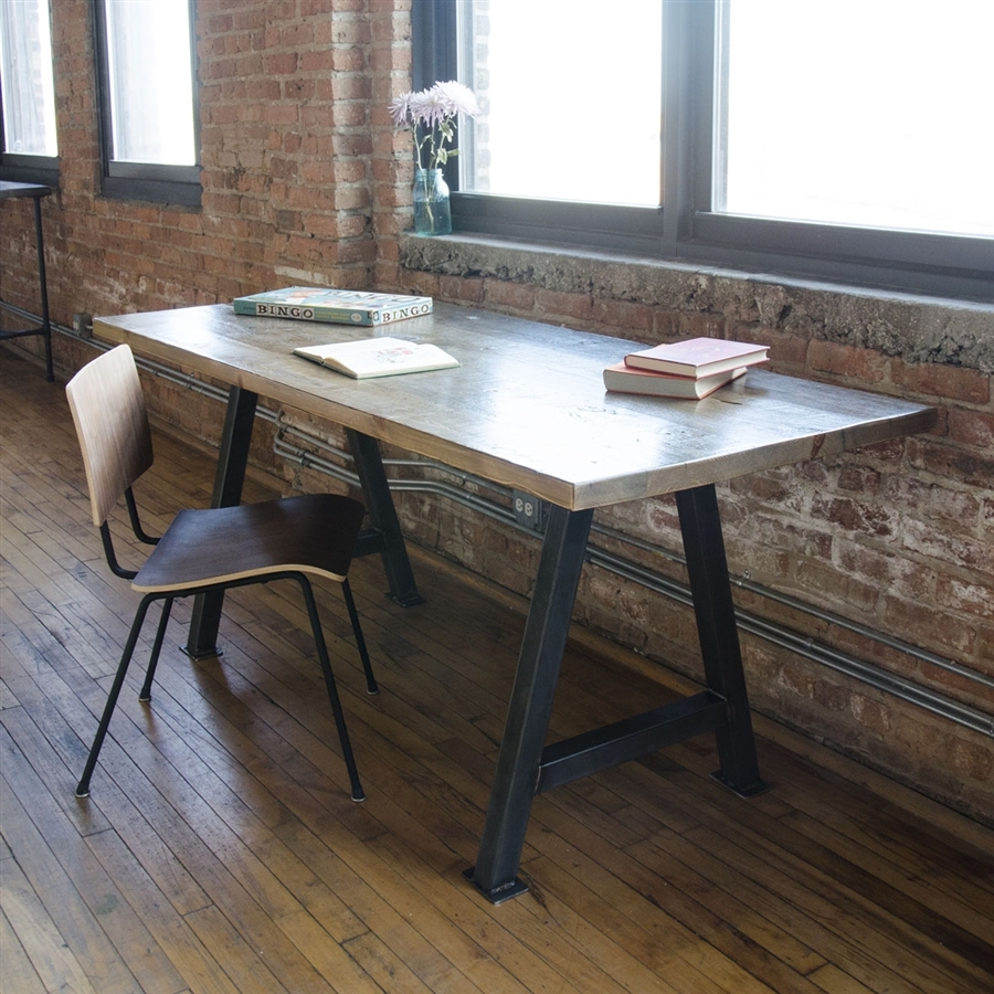 A well-lit office with rustic and industrial decor