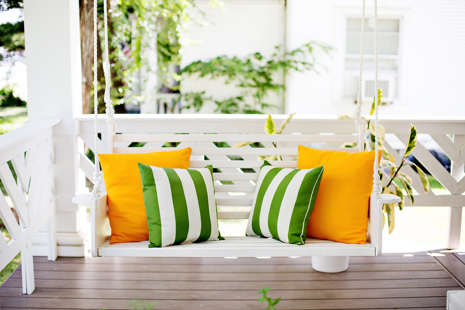 Almost hidden bright white swing with noticable pillows