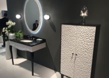 Art-deco-bathroom-with-a-sink-and-mirror-and-matching-vanity-217x155