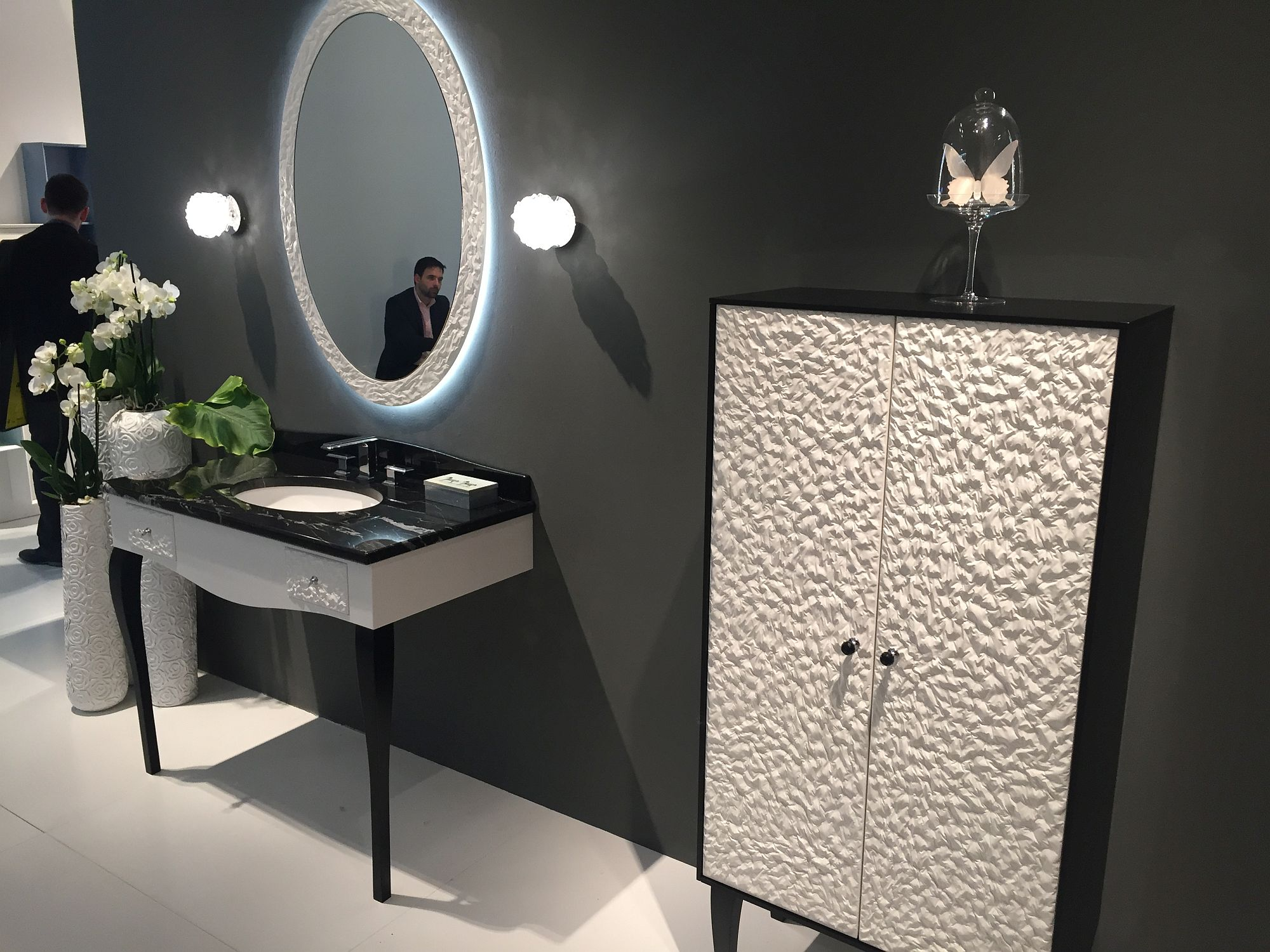 Art deco bathroom with a sink and mirror and matching vanity