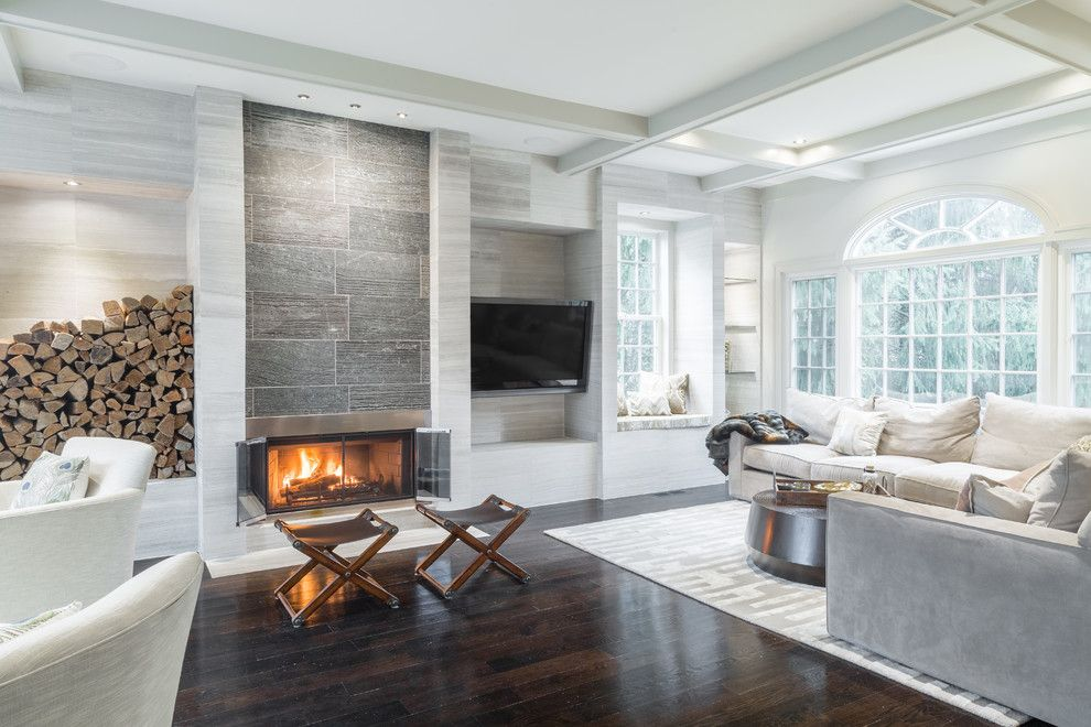 Ash limestone walls lend texture to the relaxing living room