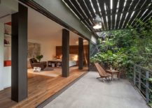 Bedroom-opens-up-completely-to-the-balcony-and-lush-canopy-outside-217x155