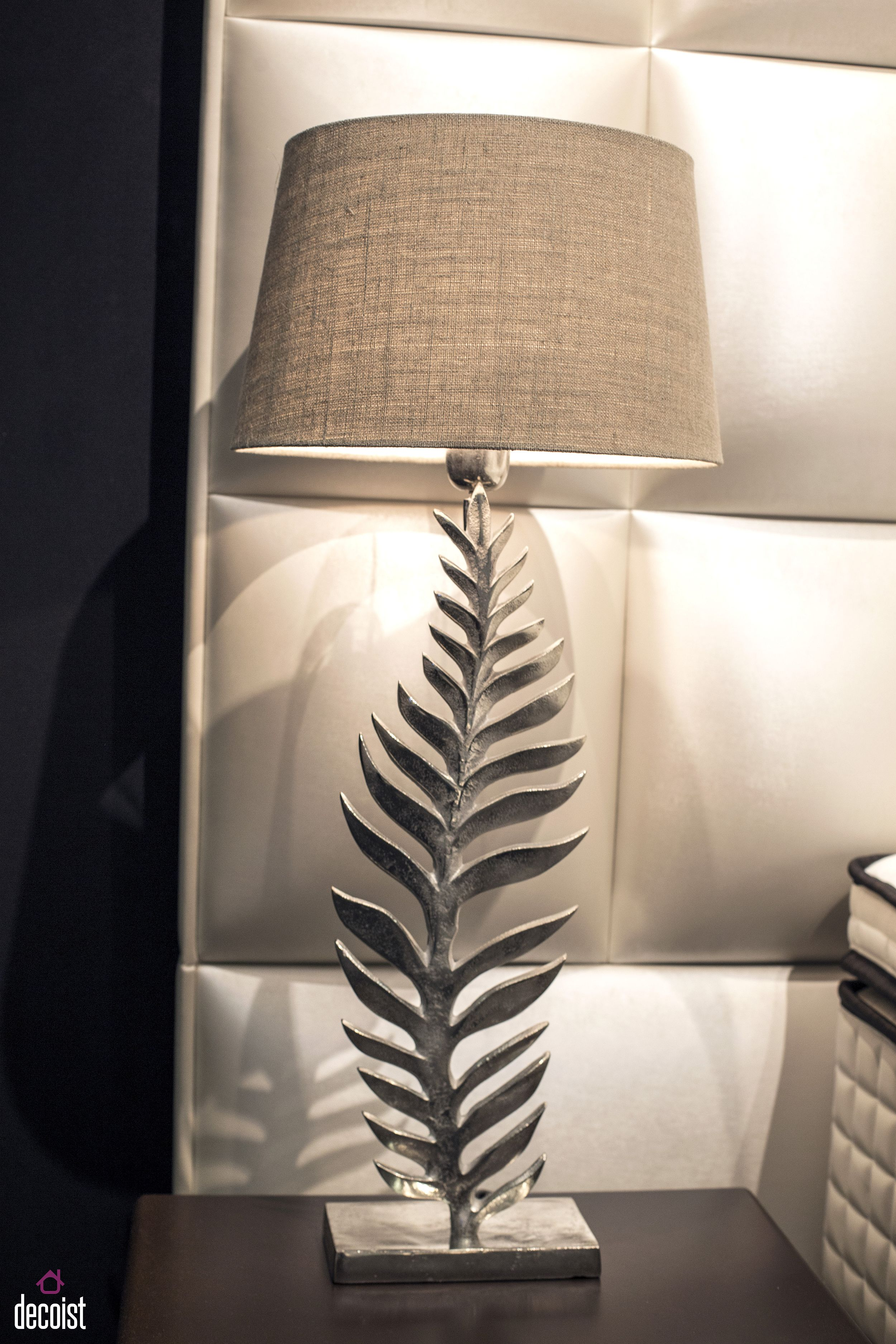 Bedside lamp with unique base features a design inspired by the shape of a leaf