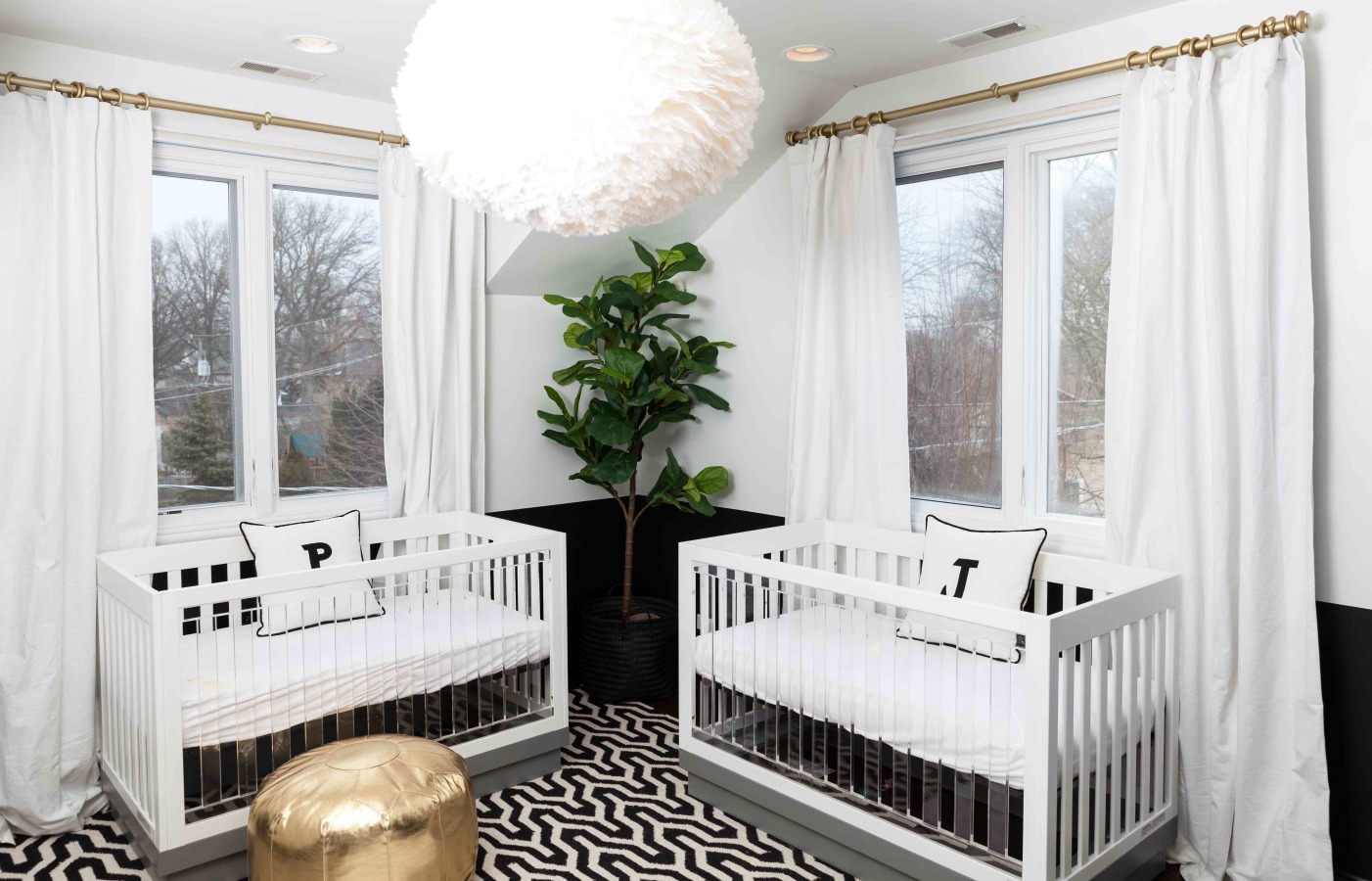 Bright white nursery with golden elements