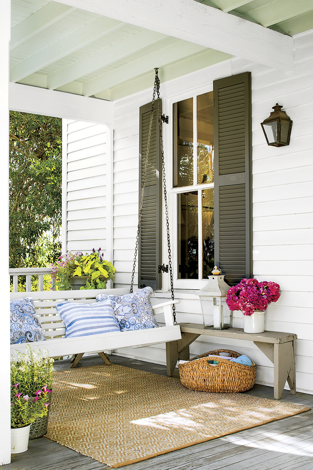 Calming porch setting with a white swing
