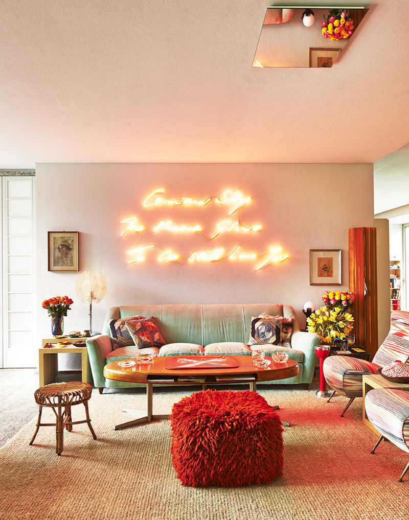 Charming living room with a blinding neon sign
