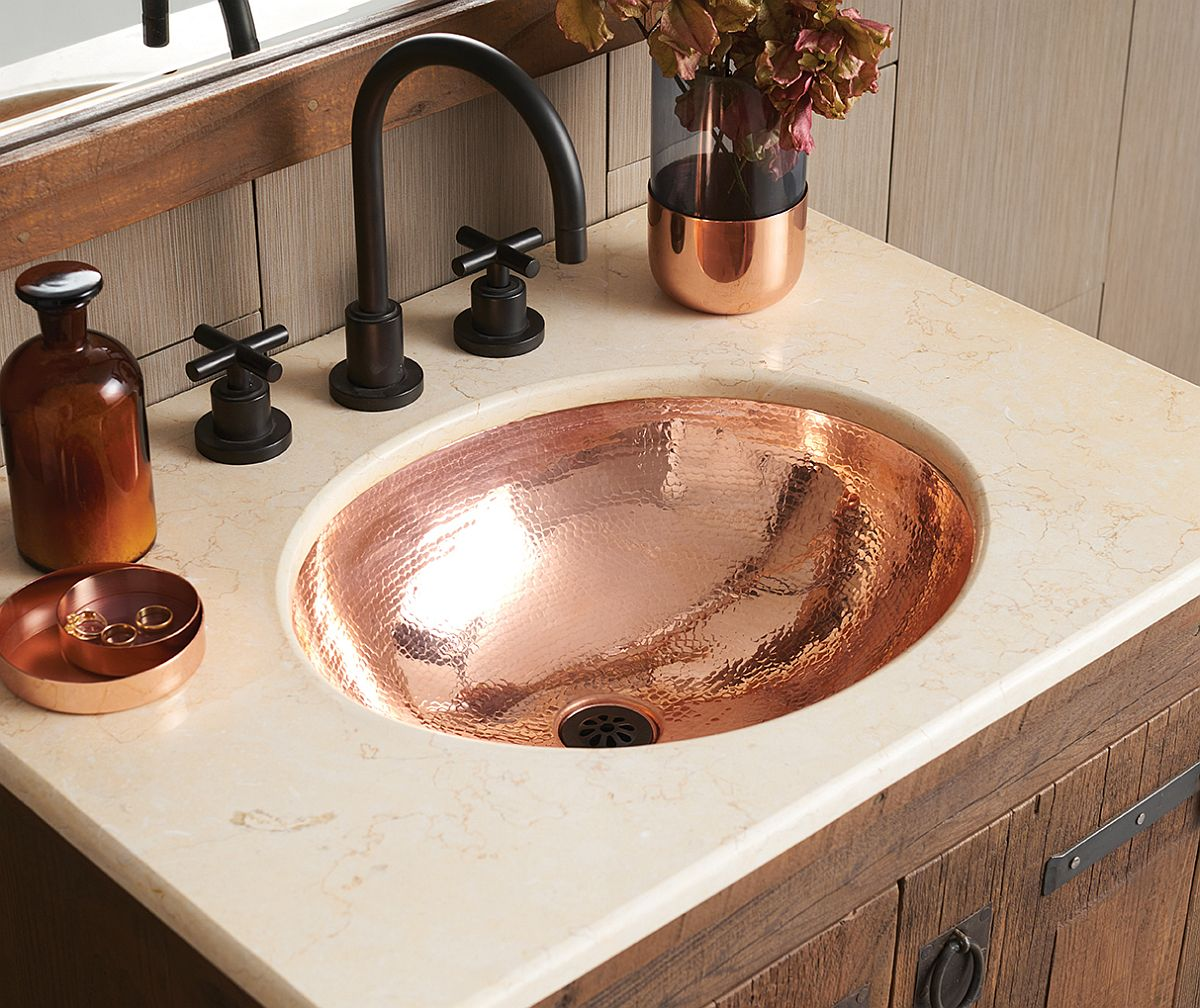 Classic Hammered Copper Bathroom sink at its shiny best!