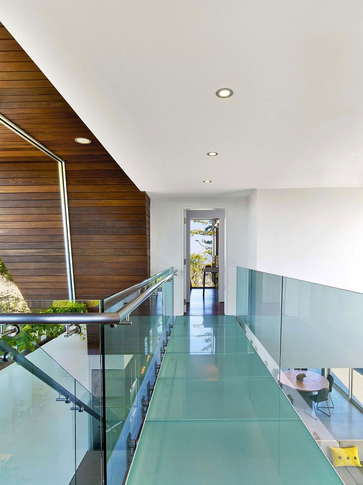 Closer look at the gorgeous glass bridge leading to the master suite