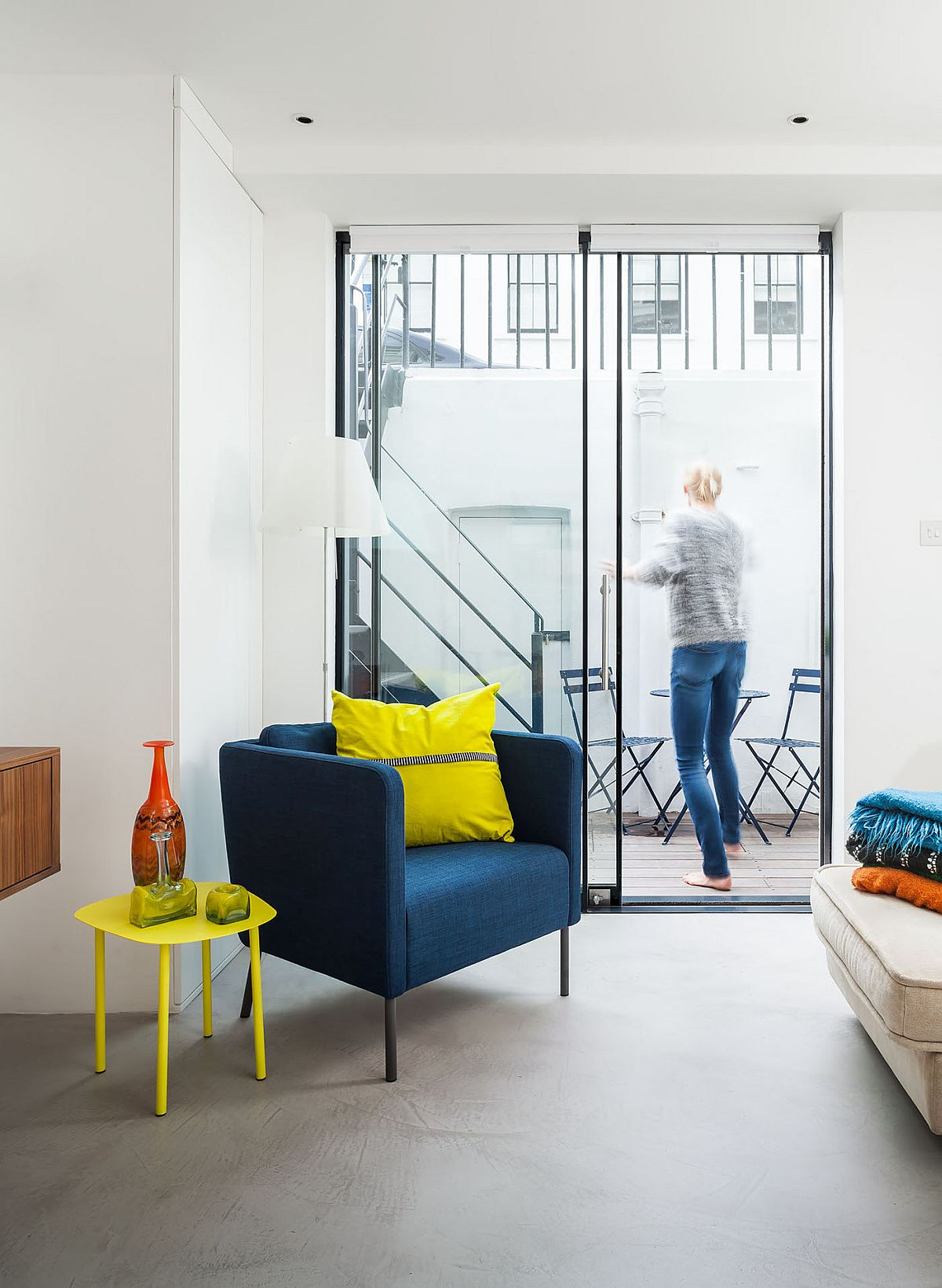 Club chair in blue and accents in yellow add color to the neutral interior Relaxing and Private: Glazed Rear Extension Breathes Life into this British Home
