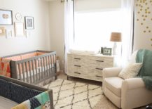 Colorful-blankers-and-a-wall-gallery-as-decor-in-a-nursery-217x155