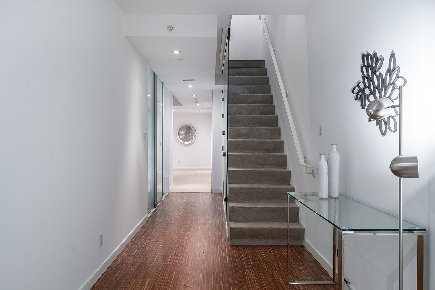 Concrete stairway with glass frame railing inside the Vancouver loft