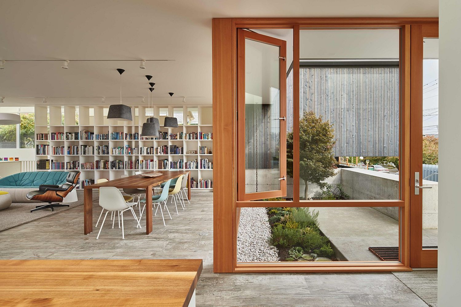 Contemporary living area of the Seattle home connected to the courtyard Comfort, Ingenuity and Connectivity with the Outdoors: Artist Residence in Seattle