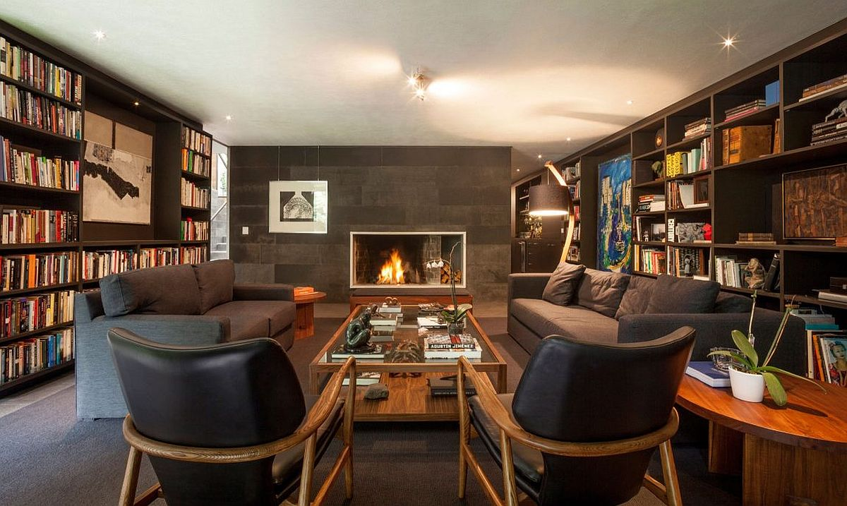 Contemporary living room and sitting space with walls of books all around