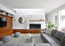 Contemporary living room in white and gray with marble fireplace and wooden accent wall 217x155 Marble, Wood and Modernity: Refined House Addition in Ottawa