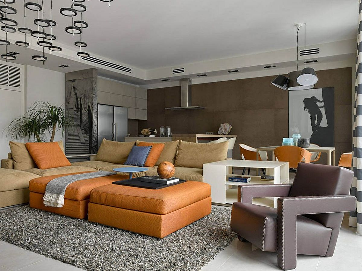 Contemporary living room of the Russian apartment with comfy leather decor and spacious vibe