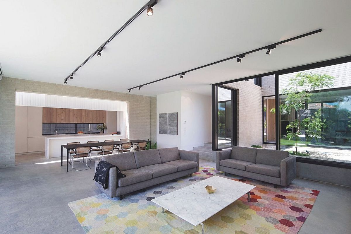 Contemporary living room with track lighting and understated decor