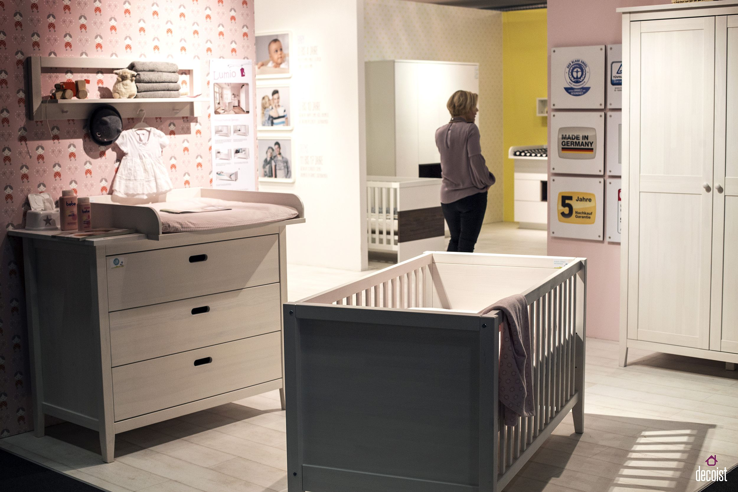 Contemporary nursery in pink with gray crib from Welle Mobel