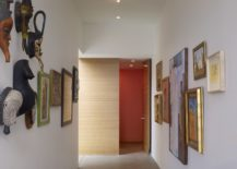 Corridor-turned-into-an-art-gallery-style-setting-using-unique-art-pieces-217x155