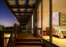 Covered-walkway-of-the-top-level-connects-the-various-bedrooms-217x155