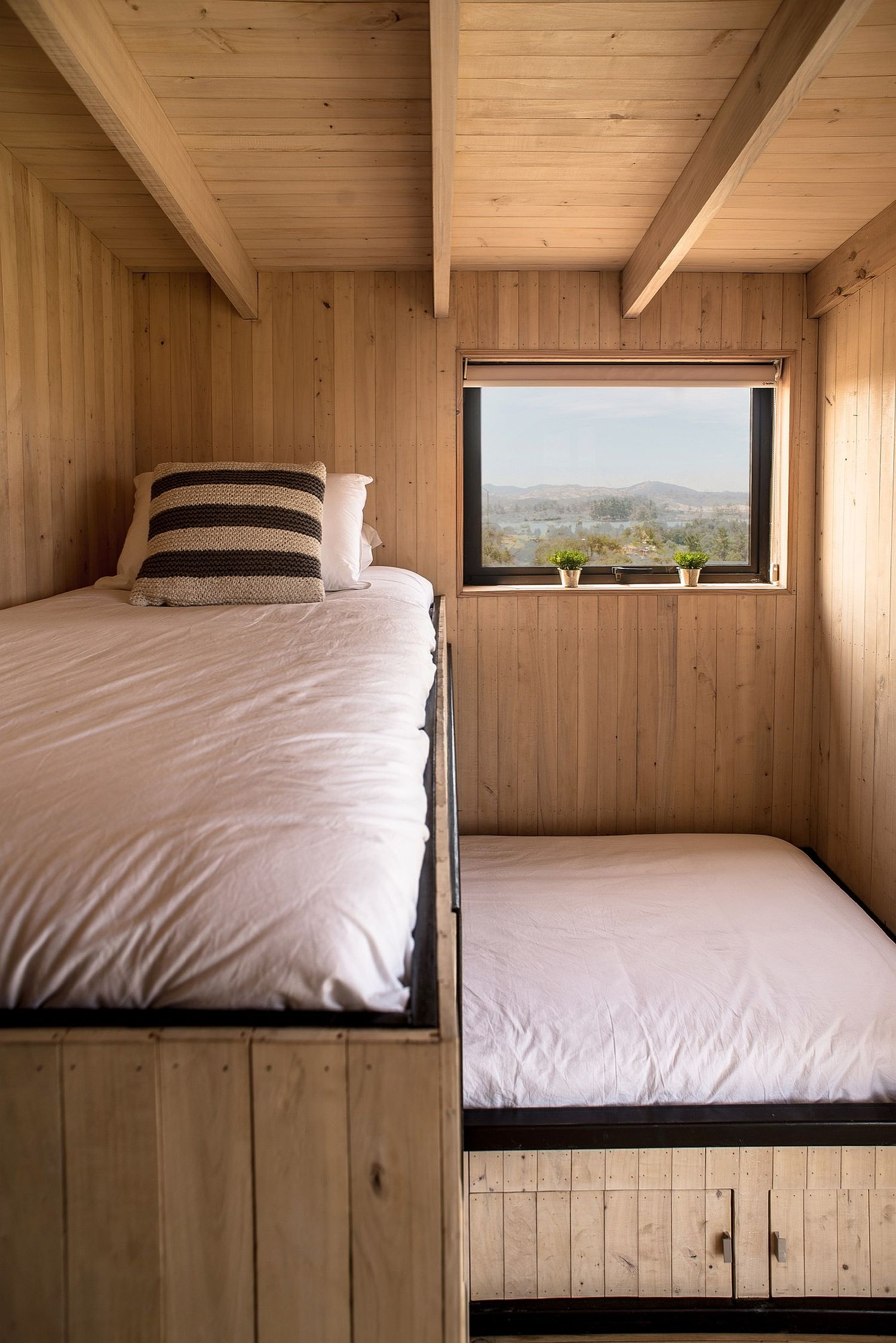 Creating space for a loft bed in the small cabin-style bedroom