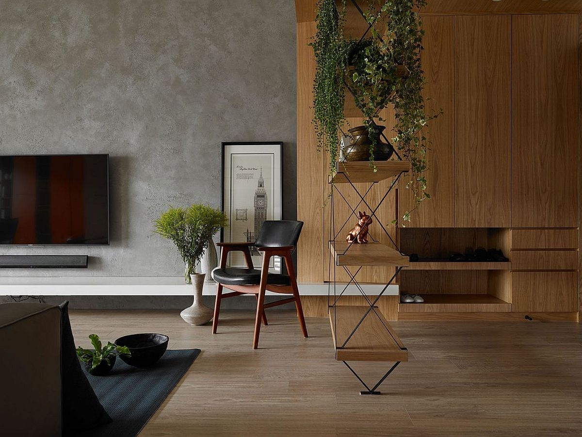 Custom hardwood and metal shelf in the living adds a gorgeous visual element to the open space
