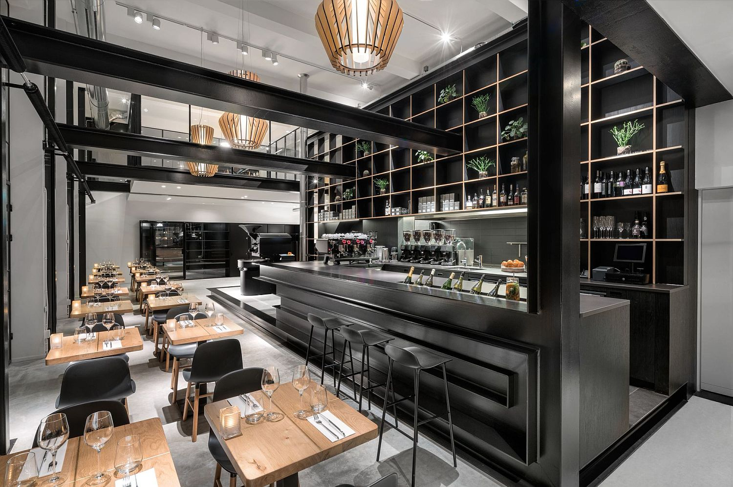 Dark metallic structure defines the new areas of the cafe