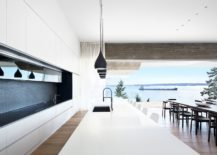 Dashing-minimal-kitchen-in-whit-with-large-island-and-black-pendant-lights-217x155