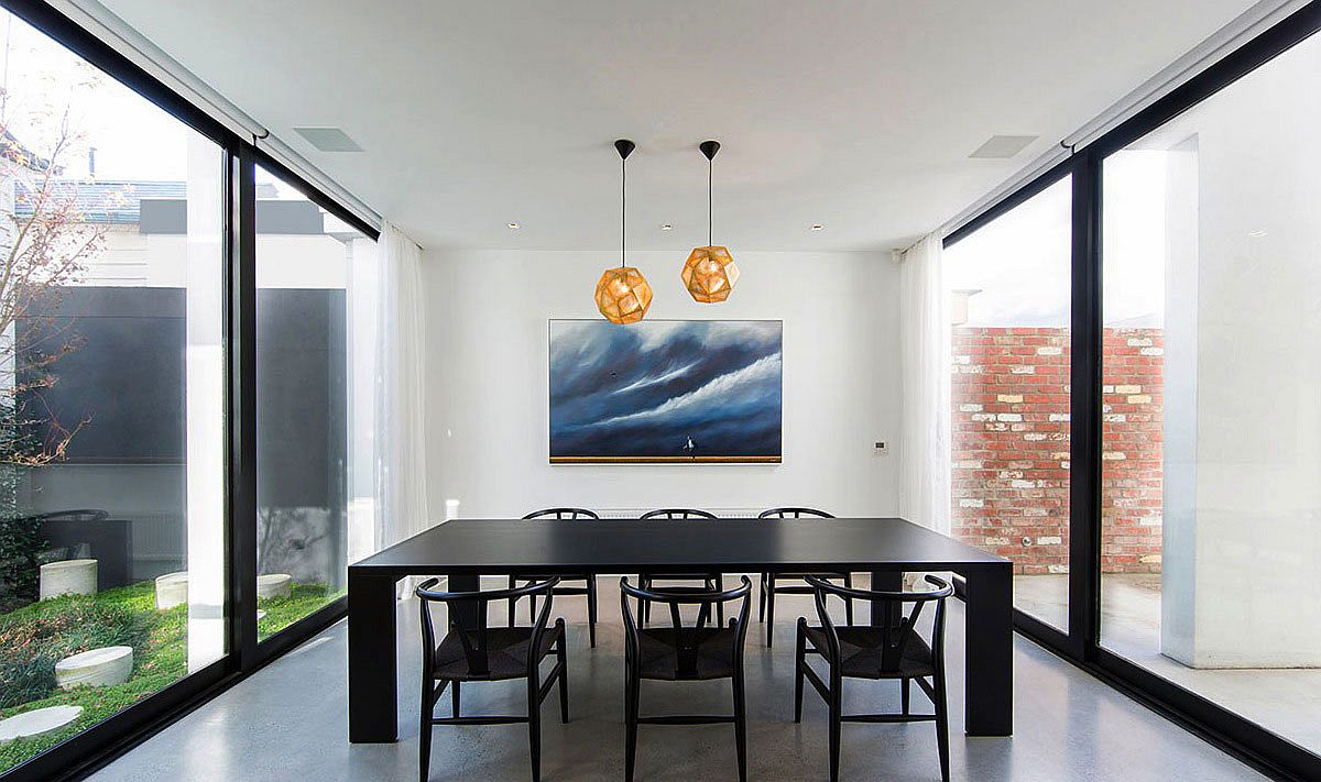 Dashing-pendant-lights-add-a-striking-focal-point-to-the-neutral-dining-space