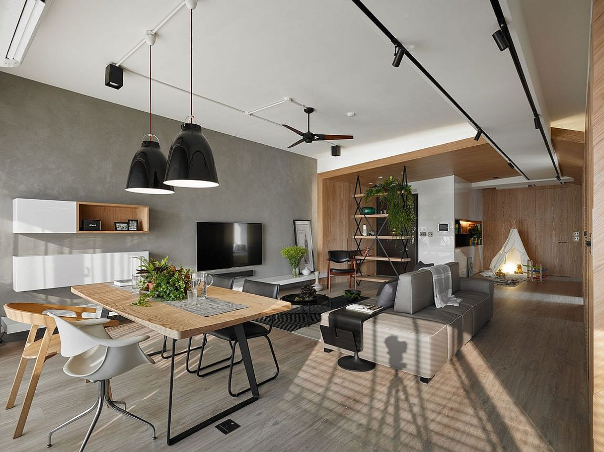 Dining area with bold pendants in black and cool recessed lighting