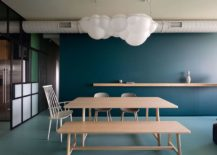 Dining-room-with-exposed-duct-pipes-and-minimal-decor-217x155