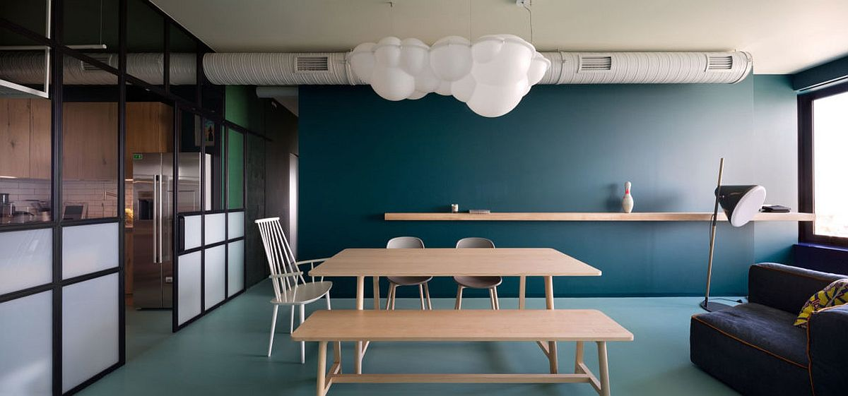 Dining-room-with-exposed-duct-pipes-and-minimal-decor