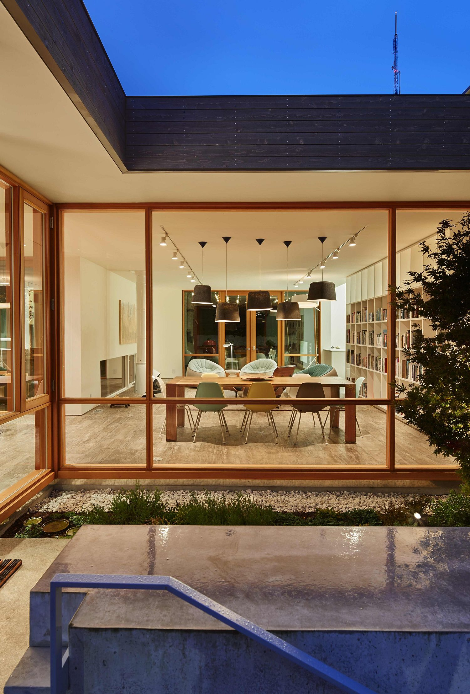 Dining space and open living space of the Artist Residence connected with the courtyard