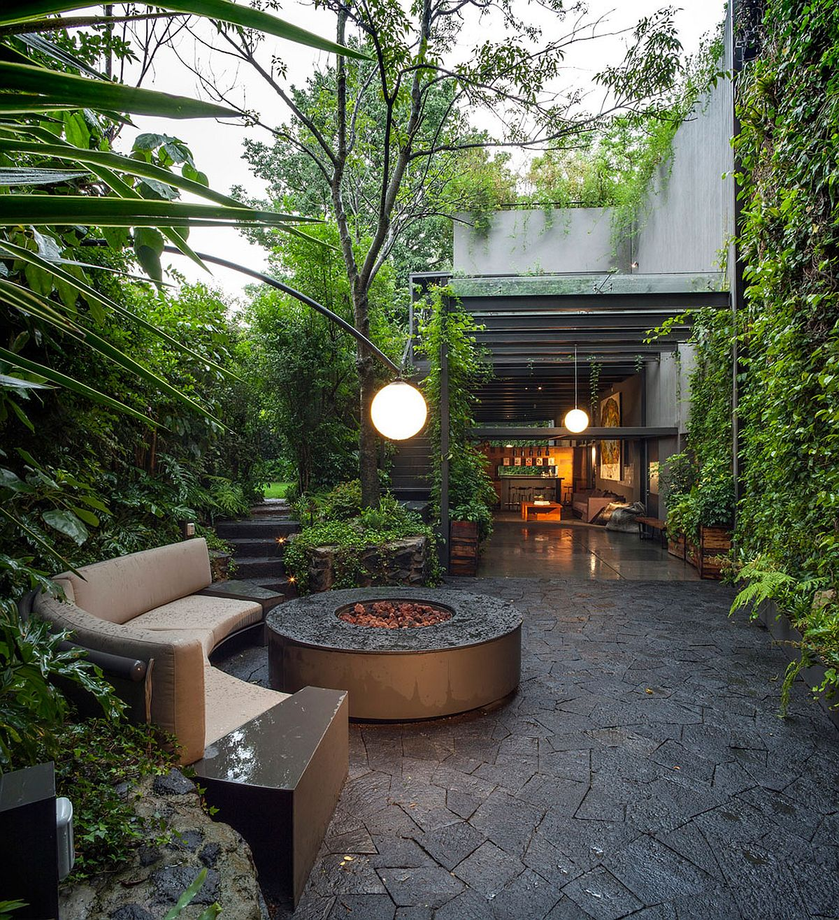 Entry courtyard and outdoor lounge of the lavish Mexican home Lavish Outdoors: Stunning Courtyards and a Cloak of Greenery Enchant at Casa O'