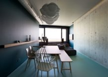 Exposed-concrete-wall-and-duct-tapes-give-the-interior-a-minimal-industrial-feel-217x155