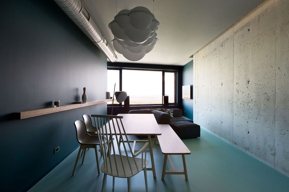 Exposed-concrete-wall-and-duct-tapes-give-the-interior-a-minimal-industrial-feel