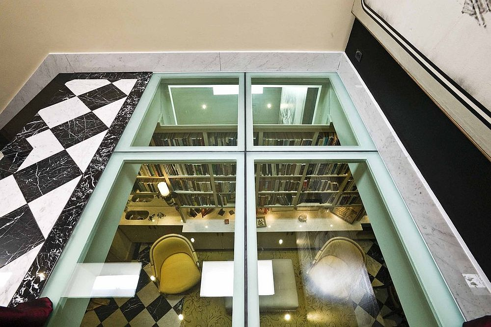 Fabulous glass flooring brings light into the lower level library [From: Jerry Jacobs Design]
