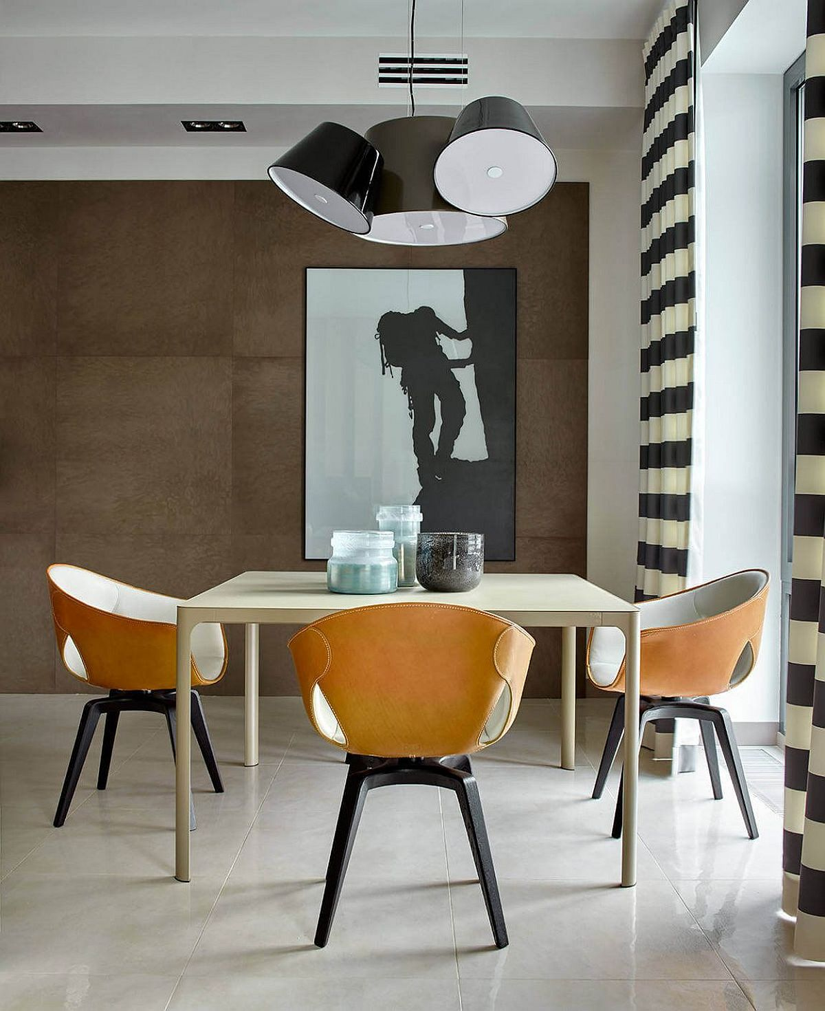 Fabulous lights and comfy chairs give the small dining area a chic appeal
