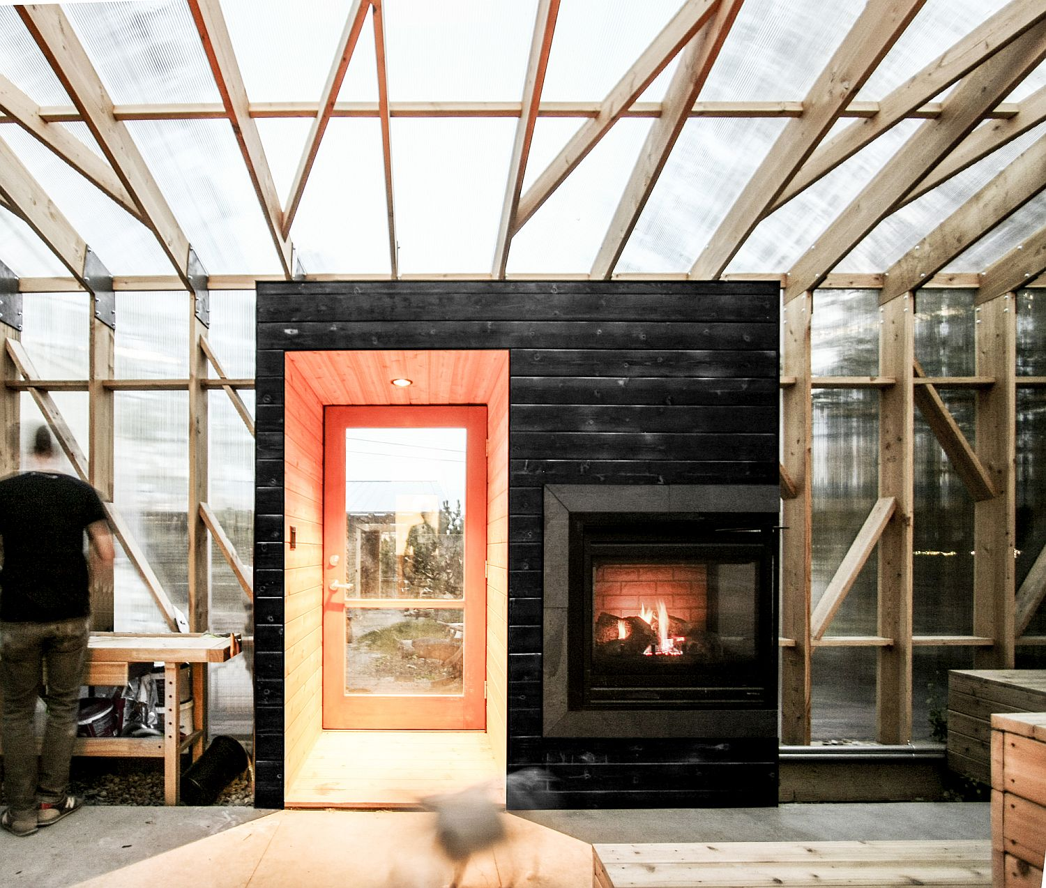 Fireplace at the entryway of the fabulous solarium gives the space a cozy appeal
