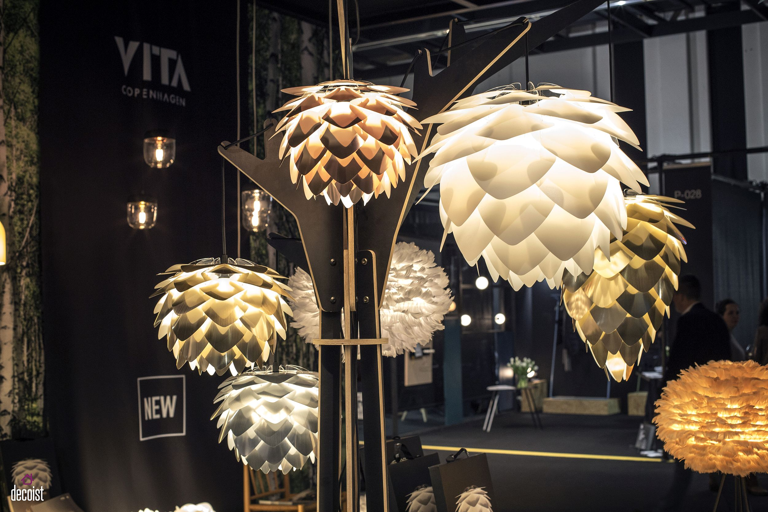Flowery lighting fixtures from Vita are bound to steal the spotlight in any room they adorn