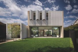 Hiding House: Confluence of Concrete, Timber and White Stained Cladding